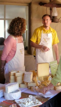 Lynne Devereux & Bryce, serving cheese
